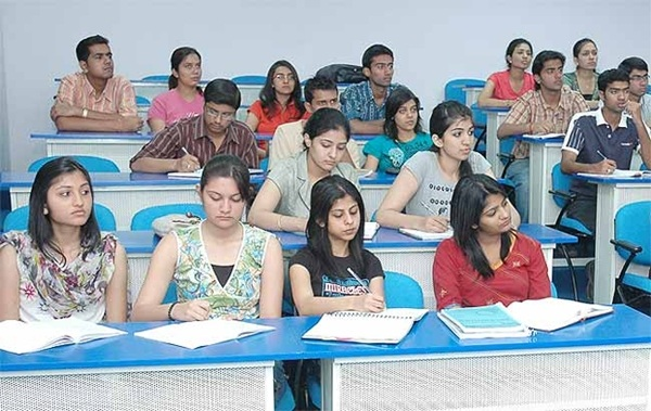 students studying in coaching classes