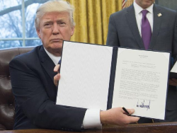 Trump showing cancellation sign