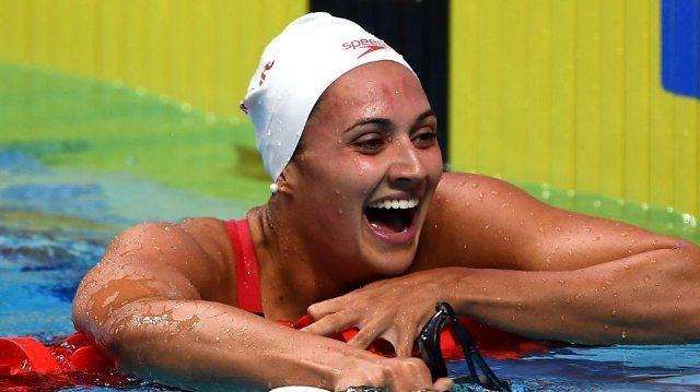 Kylie Masse wins gold in 100m backstroke=