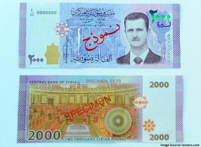 Syrian President Assad featured on banknote for first time