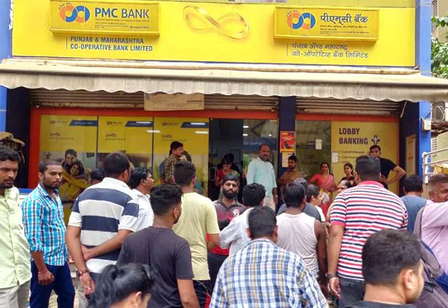 Customers at the PMC Bank's branch