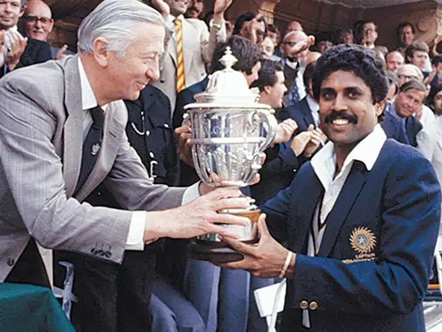 Former Indian Captain Kapil Dev receiving ICC World Cup Trophy